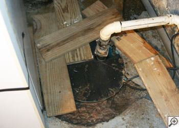An ugly, clogged sump pump system in Sunburst, Montana
