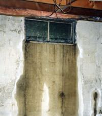 Flooding through basement windows in a Cut Bank home.