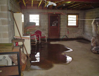 a flooded basement floor in a Cut Bank home