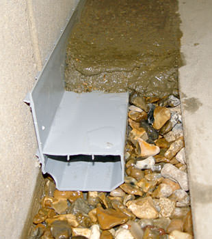 A basement drain system installed in a Sunburst home